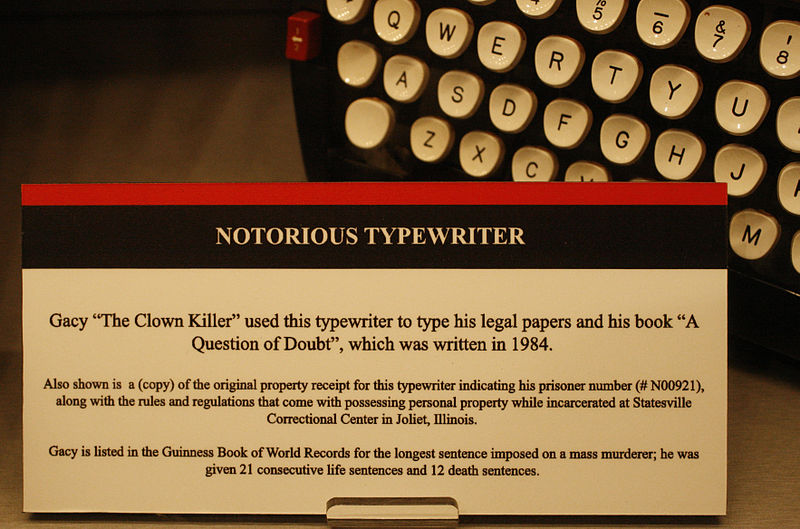 A typewriter with a card explaining it belonged to Gacy